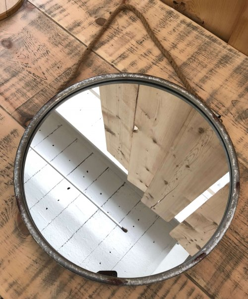 Round Metal Mirror Rope Hanger from arkvintage.com. Industrial style round mirror. It has a metal frame with rope to hang on the wall. Classic rustic look, a real eye catcher! shop buy online vintage camberley surrey
