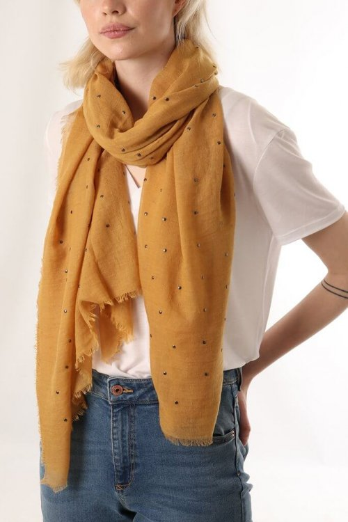 Scarf With Metal Studs msh at arkvintage. A copper/mustard colour scarf with matte gun metal studs throughout. Really cool urban look and feel. Check out the pictures for more detail. Shop and buy now online or in store, Camberley Surrey.