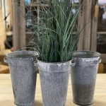 Metal Florist Pots, from Arkvintage. Beautifully made, with a classic tapered design. They have an aged patina, giving a unique finish to each one. arkvintage rust resistant
