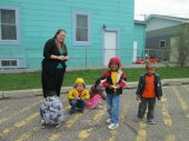 Rachel and the preschoolers enjoying some outside time!
