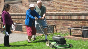 Jim showed some of the students how to use a lawnmower.
