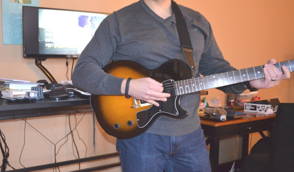 "Your review author ""rocking out"" with the StrapSnake guitar strap."