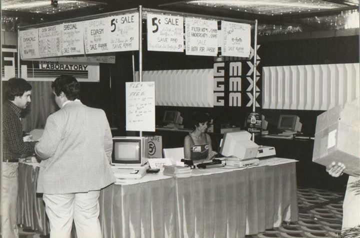 "Frank Hogg: ""Bob Phillips of GMX, Rich Hogg did all the software, drivers, etc., for Flex and OS9 and Carol Sprague behind the table."""