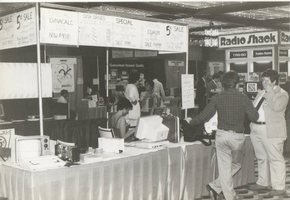 "Another booth. According to Frank Hogg, ""Carol Sprague in the booth, Bob Phillips from GMX talking to Rich Hogg."""