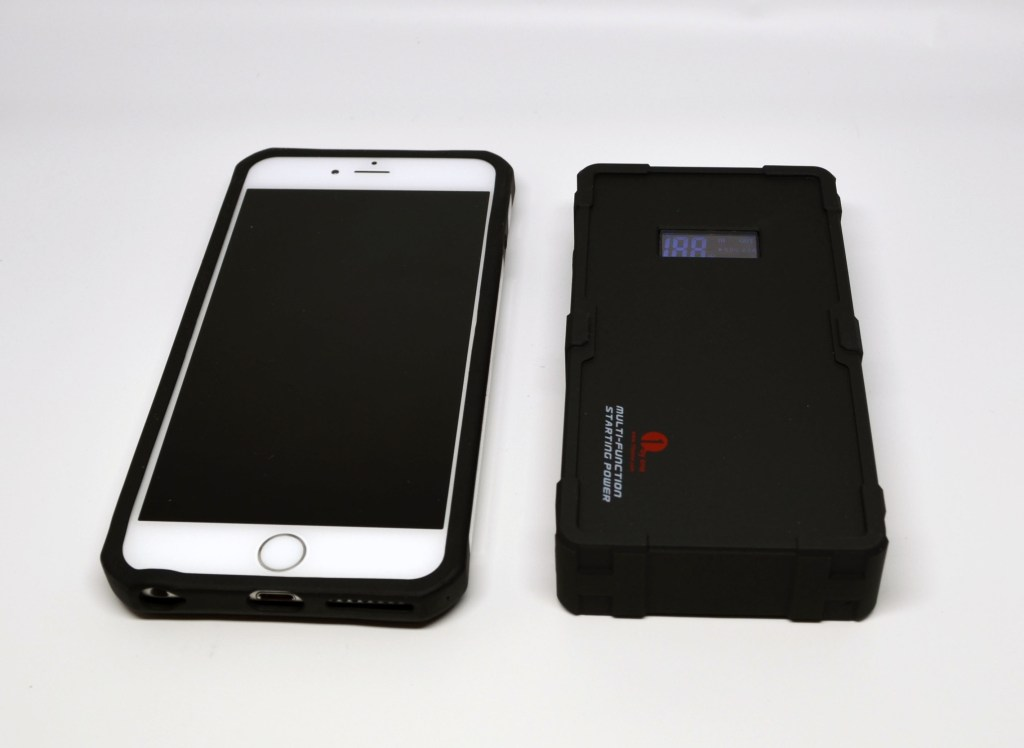 To the right is the main unit, and to the left is an Apple iPhone 6 Plus. As can be seen from the size comparison, it's an incredibly compact unit for all of its features.