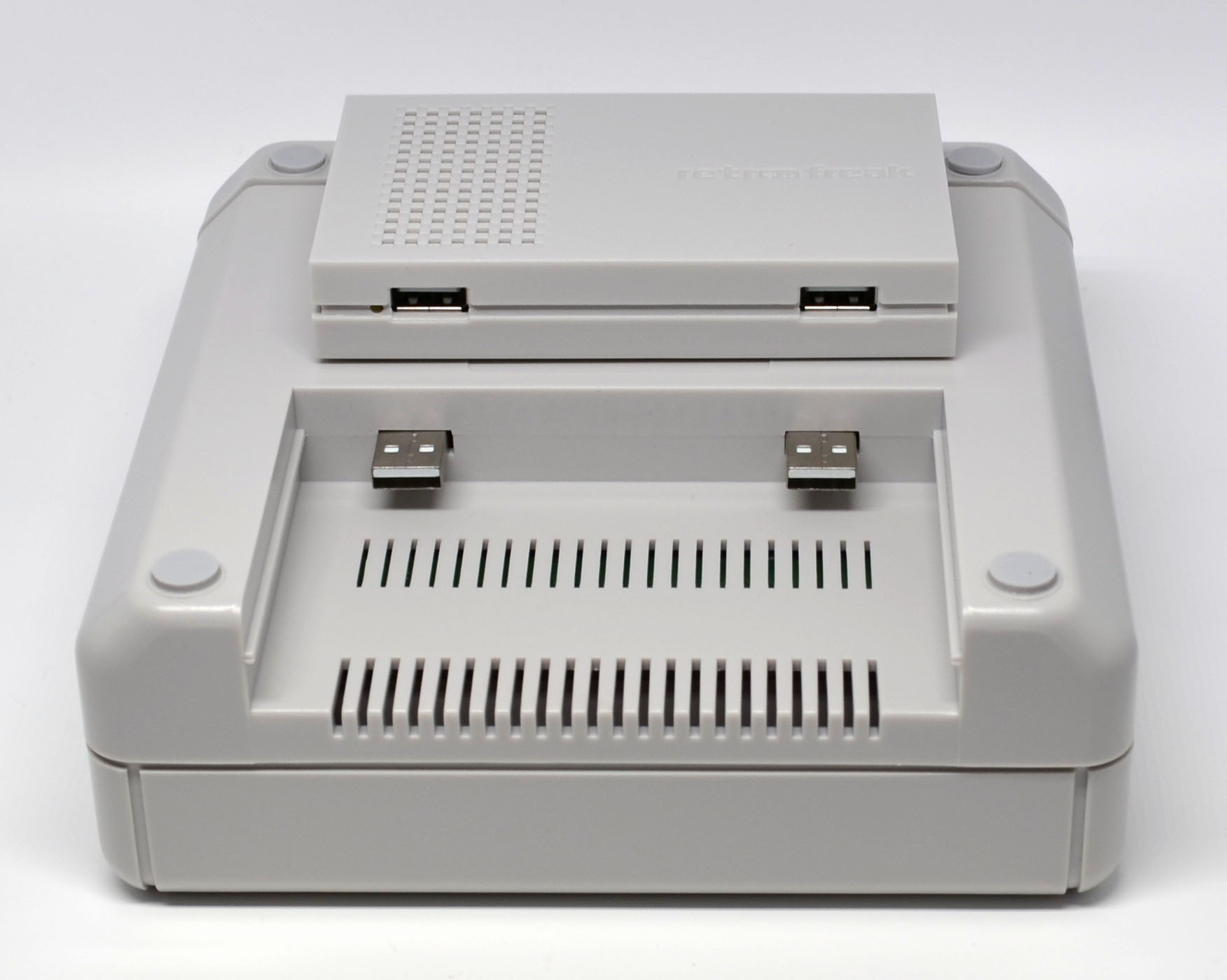 The main part of the console sitting on top of the bottom of the cartridge unit.