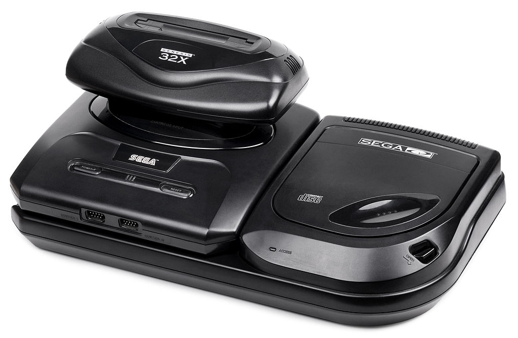 Sega Genesis Model 2, Sega CD 2, and Sega 32X. No one wants this scenario again. Image courtesy of: By Evan-Amos - Own work, Public Domain, https://commons.wikimedia.org/w/index.php?curid=14303771