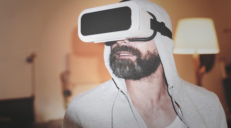 A man wears a virtual reality headset (via Pexels)