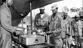 SFC Arnold S. Scales of Richmond, Va., serves steak at the 43rd Transportation Truck Company, 8th U.S. Army, near Uijongbu, Korea, on 18 June 1951. (Photo: Army Quartermaster Museum)