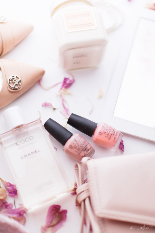 Laura Mercier Body Butter in Creme Brule, Coco Mademoiselle by Chanel, pink flat lay photographed by Armenyl.com