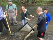 "Students learn about collecting and identifying ""macros"" in Cowanshannock Creek"
