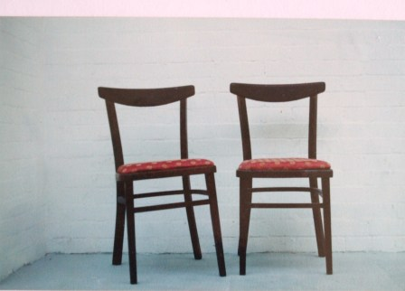 Two renovated chairs stood side by side.