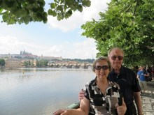 Kathy and Arnie with the Charles Bridge and Vltava River in the background