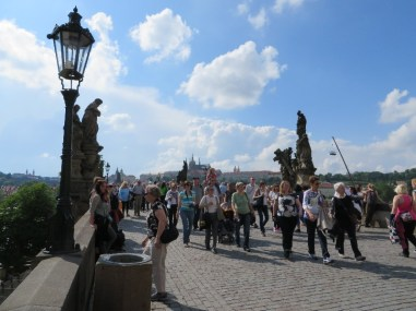 Big tourist crowds on the Charles Bridge on a hot Saturday