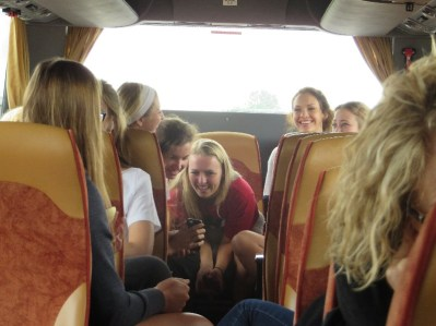 The team shares a moment on the bus ride from Venice to Milan