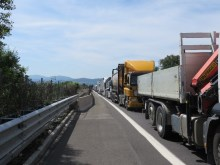 Waiting with miles of trucks to get past the blocked tunnel north of Bologna