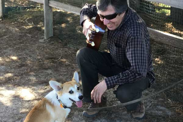 Arnie Gamble and corgi puppy Monterey, California.