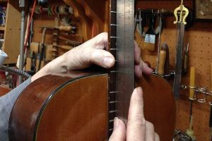 Arnie Gamble checking the fit on a Martin neck reset.
