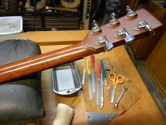 fixing a broken head stock on martin guitar, authorized martin service center