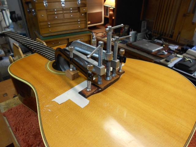 Replacing and regluing the bridge on Martin guitar.