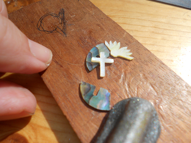 The cut out pieces of pearl and abalone for the head inlay.