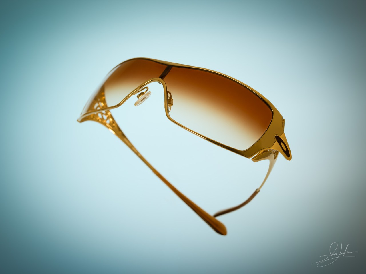 A pair of very stylish gold sunglasses