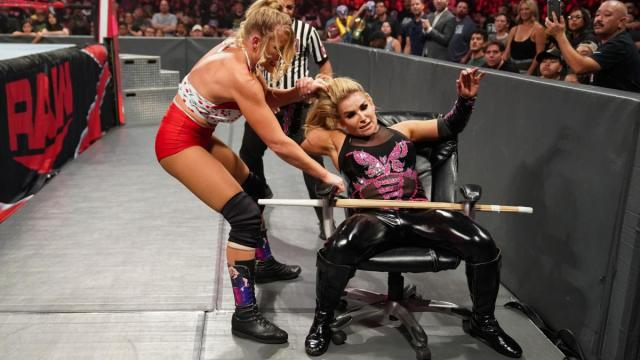 Lacey Evans traps Natalya in a chair with a kendo stick