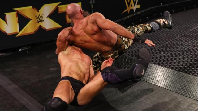 Tommaso Ciampa and Finn Blor after Balor took and Air Raid Crash on the ramp
