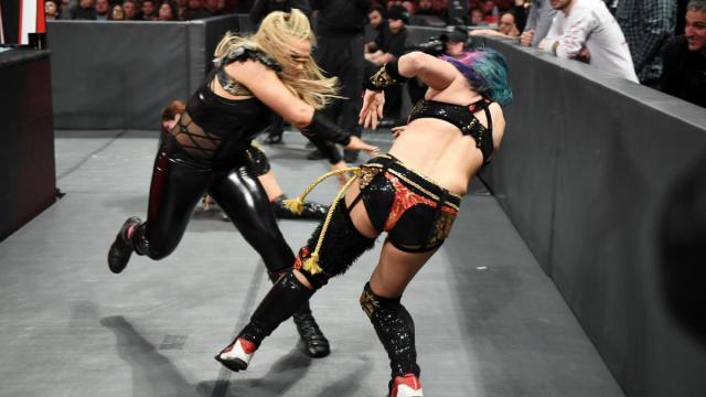 Natalya shoves Asuka into the barricade