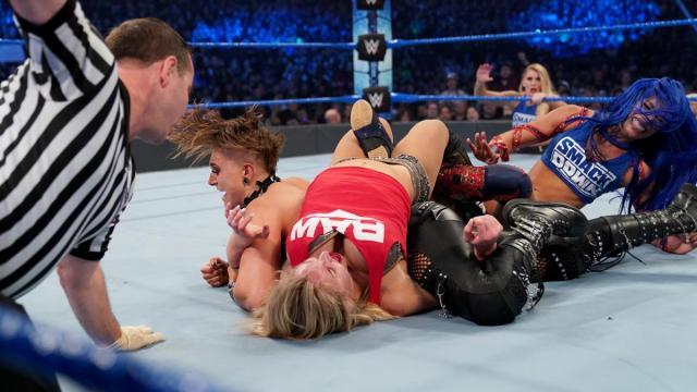 Rhea Ripley pins Charlotte Flair while Flair has Becky Lynch in the Figure Eight