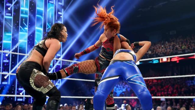 Becky Lynch tries to take out Bayley and Shayna Baszler
