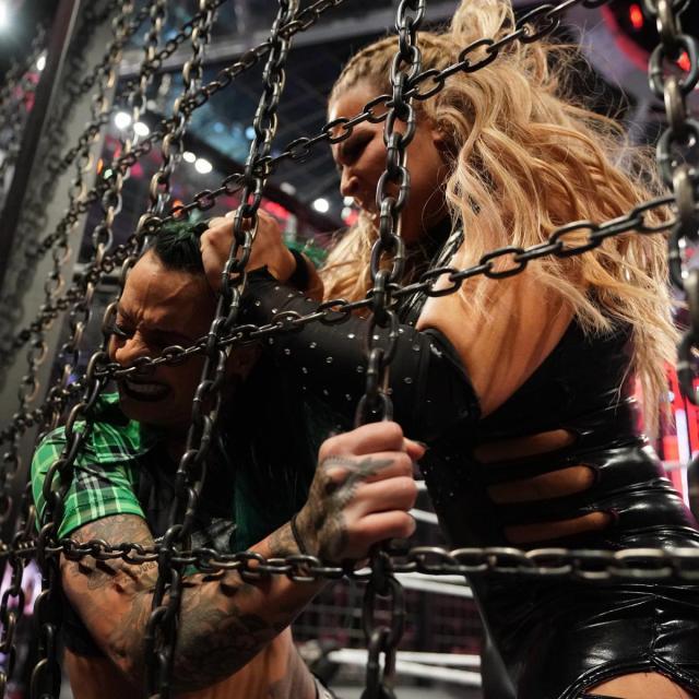 Natalya mashes Ruby Riott into the chamber