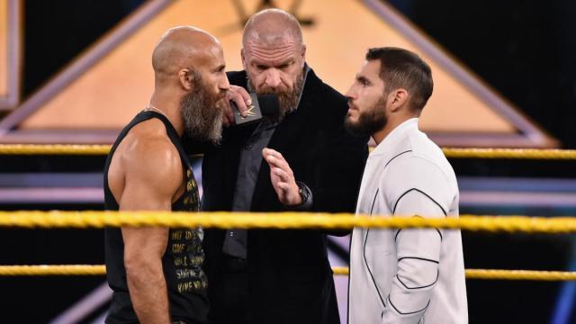 Triple H gets between Johnny Gargano and Tommaso Ciampa