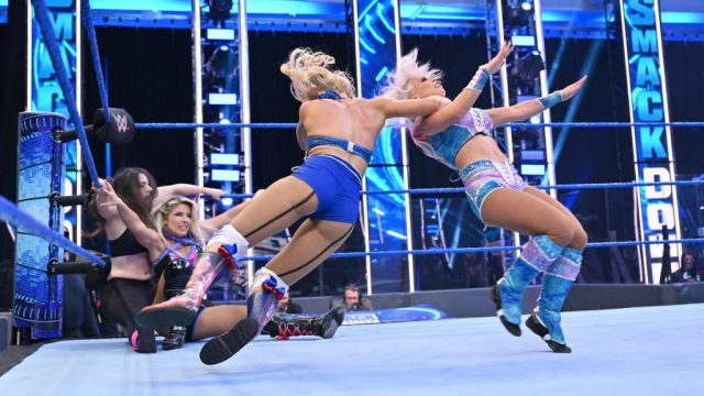 Lacey Evans takes down Dana Brooke while Alexa Bliss and Nikki Cross are down in the corner.
