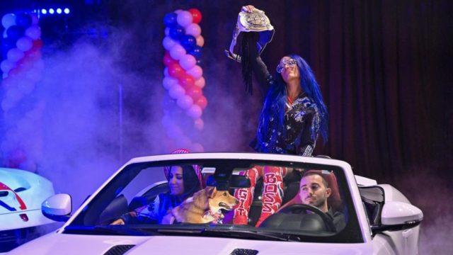Sasha Banks is driven to the ring with Bayley and Banks' dog.