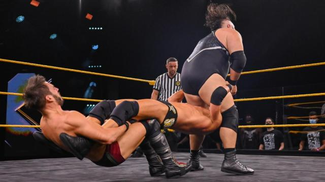 Johnny Gargano catapults Roderick Strong's head into Bronson Reed's balls