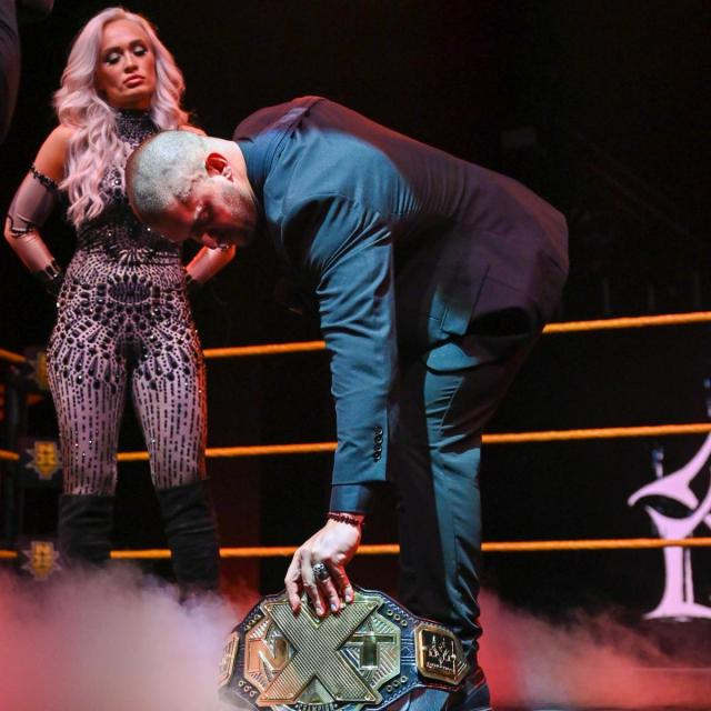 Karrion Kross and Scarlett lay down the title