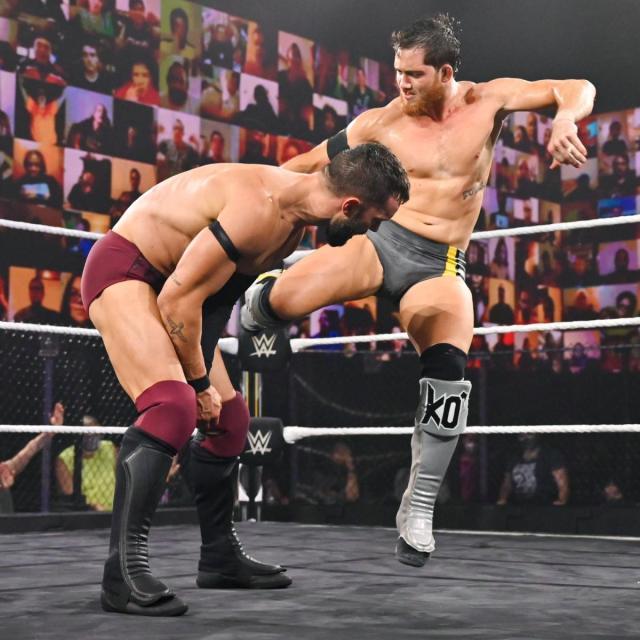 Kyle O'Reilly kicks Finn Balor