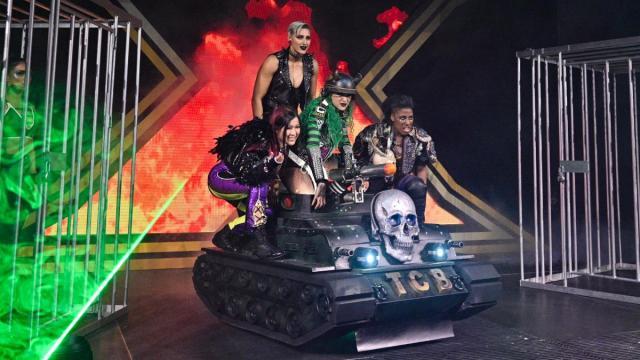 Team Blackheart pose on Shotzi Blackheart's new tank before the WarGames match