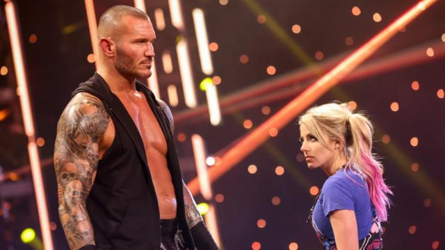 Alexa Bliss stares at Randy Orton as they pass on the ramp