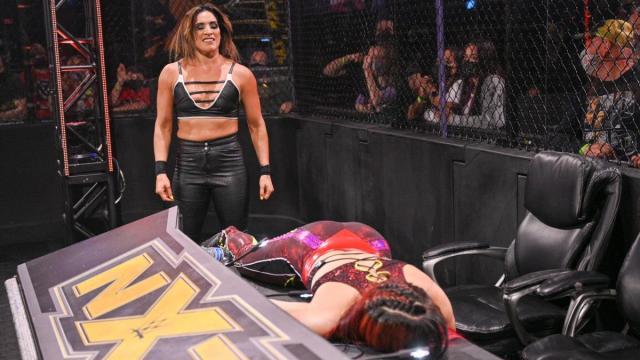 Raquel Gonzalez leaves Io Shirai laid out on the announce desk