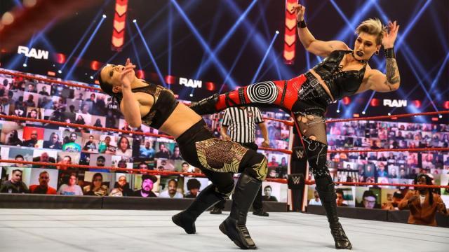 Rhea Ripley kicks Shayna Baszler