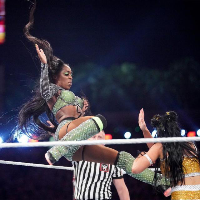 Naomi kicks Billie Kay in the head