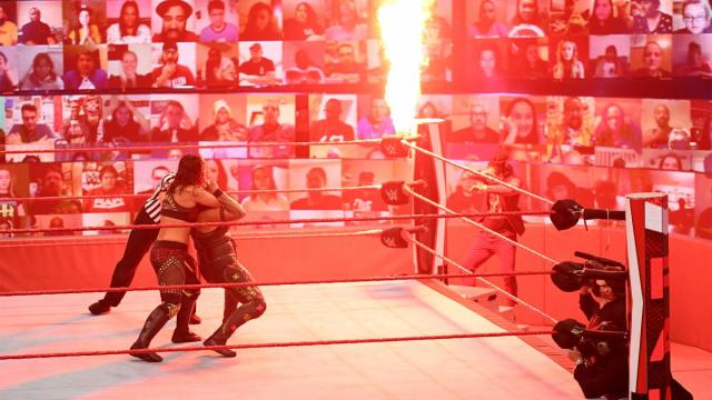Fire shooting out of the ringpost scares Shayna Baszler and Tamina and knocks Reginald off the steps