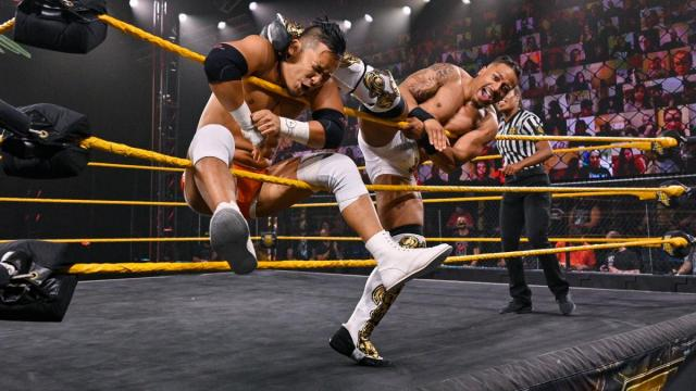 Carmelo Hayes kicks Kushida while Kushida's in the ropes
