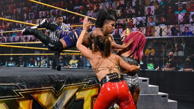Ember Moon takes out Raquel Gonzalez and Dakota Kai with a suicide dive