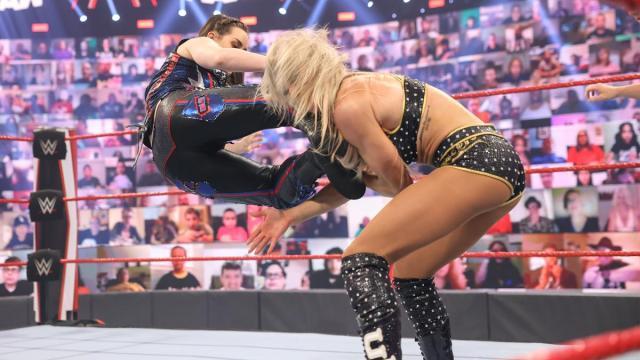 Nikki Cross kicks Charlotte Flair in the head