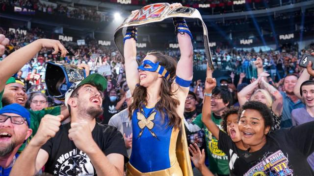Nikki A.S.H. celebrates her title win with the RAW crowd