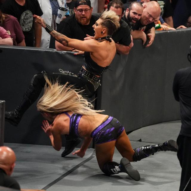 Charlotte Flair chop blocks Rhea Ripley