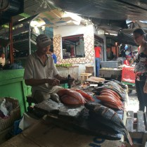 Fish monger at the Mercado